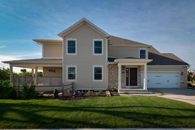 670 Greystone Dr, Port Washington, WI 53074 (#1545725) :: Tom Didier Real Estate Team