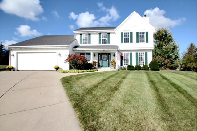 869 Joshua Ct, Pewaukee, WI 53072 (#1549870) :: Vesta Real Estate Advisors LLC