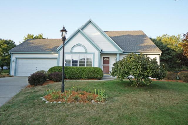 533 Greenwood Ct, Pewaukee, WI 53072 (#1550685) :: Vesta Real Estate Advisors LLC