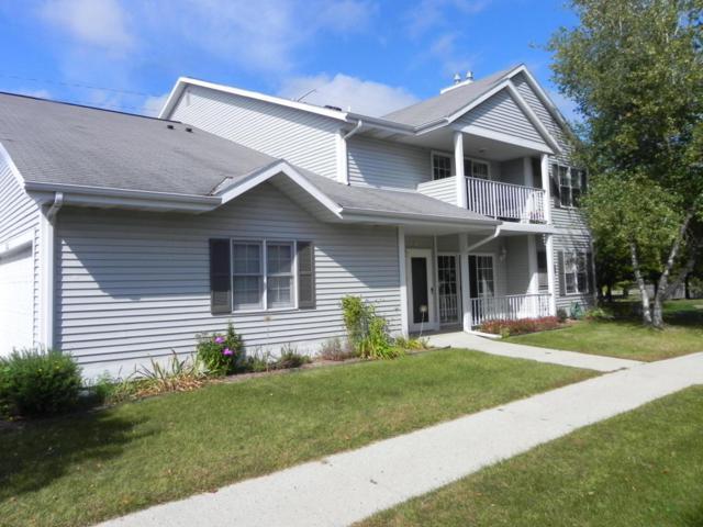 104  B Bur Oak Ln, Grafton, WI 53024 (#1551229) :: Tom Didier Real Estate Team