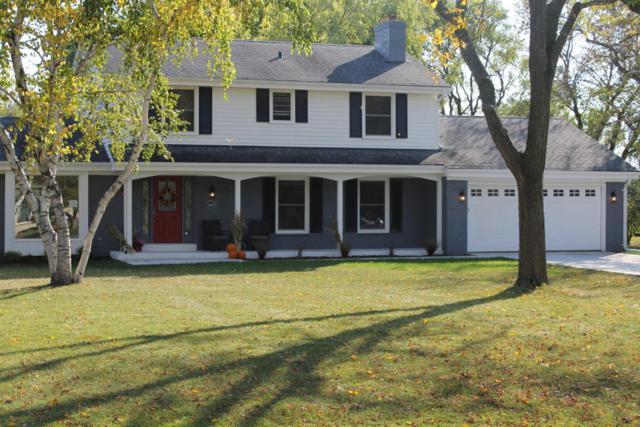 1429 W River Oaks Ln, Mequon, WI 53092 (#1554588) :: Tom Didier Real Estate Team