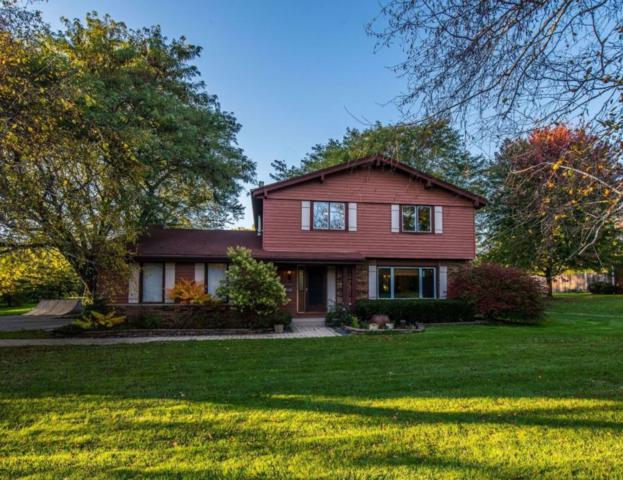 1496 Woodland Dr, Grafton, WI 53024 (#1555332) :: Tom Didier Real Estate Team