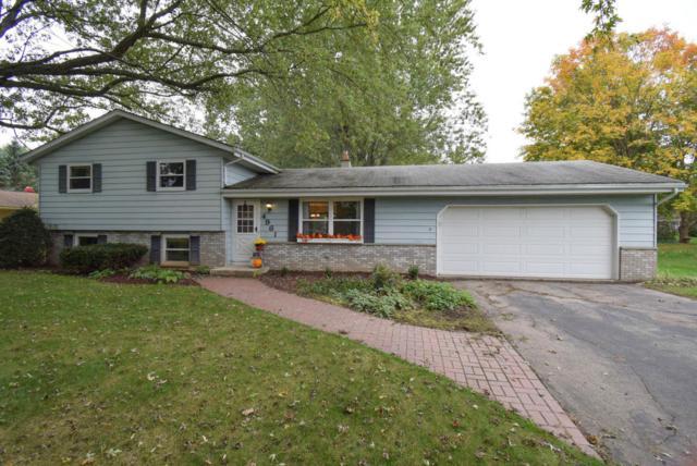 4961 Eagle Ln, West Bend, WI 53095 (#1555960) :: Tom Didier Real Estate Team