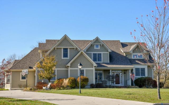 618 Pond View Ct, Pewaukee, WI 53072 (#1558113) :: Vesta Real Estate Advisors LLC