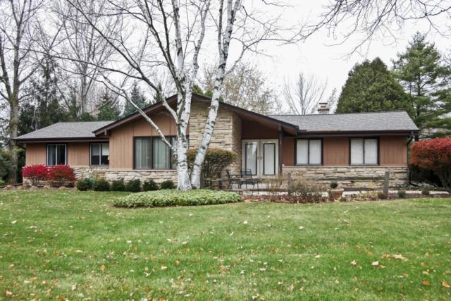 1506 W River Oaks Ln, Mequon, WI 53092 (#1558875) :: Vesta Real Estate Advisors LLC