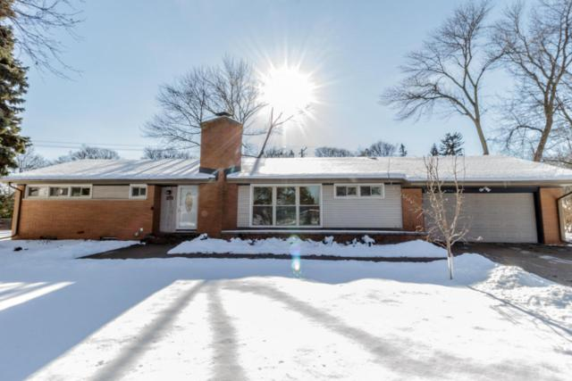 7017 N Lombardy Ct, Fox Point, WI 53217 (#1562921) :: Tom Didier Real Estate Team