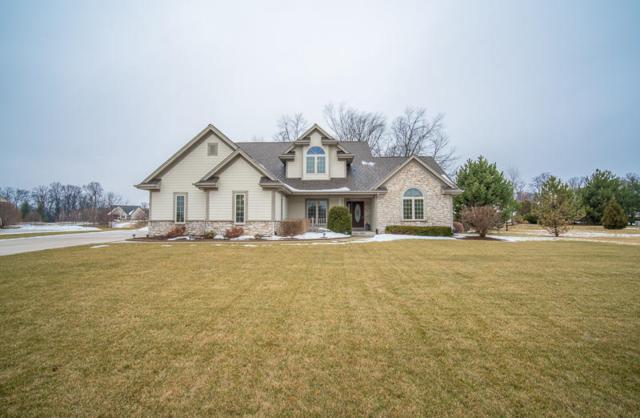 W144 N9869 Sun Valley Trl, Germantown, WI 53022 (#1563084) :: Vesta Real Estate Advisors LLC