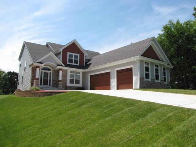 N64W15195 Mill Rd, Menomonee Falls, WI 53051 (#1563327) :: Vesta Real Estate Advisors LLC
