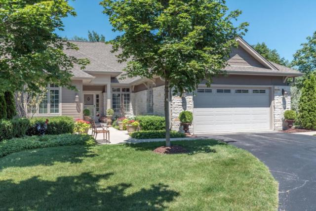7342 W Heron Pond Dr, Mequon, WI 53092 (#1563482) :: Tom Didier Real Estate Team