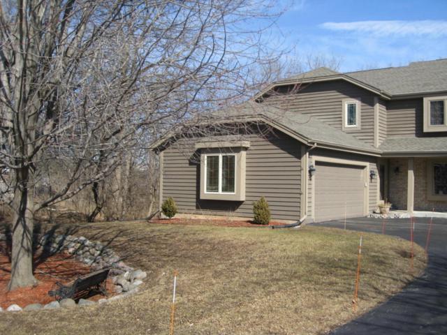 N30W23470 Greenfield Ct B, Pewaukee, WI 53072 (#1569028) :: Vesta Real Estate Advisors LLC
