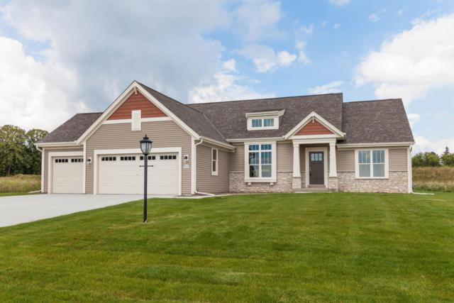 W223N4647 Seven Oaks Dr, Pewaukee, WI 53072 (#1570999) :: Vesta Real Estate Advisors LLC