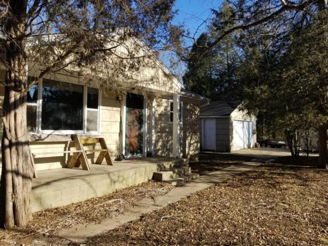 1528 N Green Bay Rd, Grafton, WI 53024 (#1571288) :: Vesta Real Estate Advisors LLC