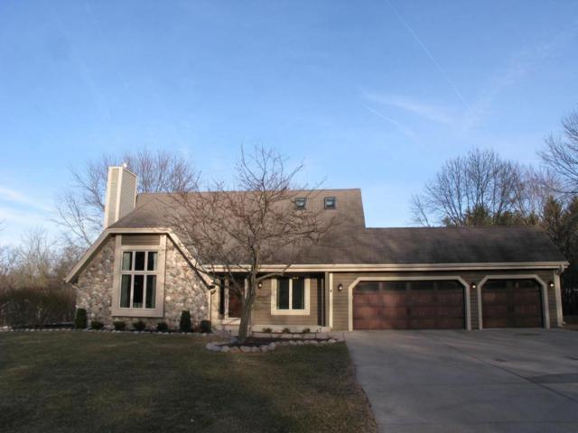W276N1880 Spring Creek Dr, Pewaukee, WI 53072 (#1571793) :: Vesta Real Estate Advisors LLC