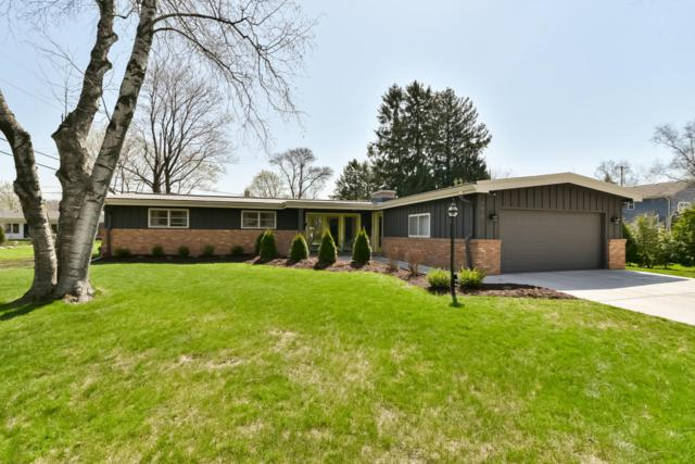 7610 N Regent Rd, Fox Point, WI 53217 (#1579610) :: Tom Didier Real Estate Team