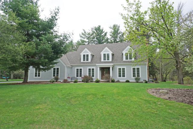 230 White Pine Rd, Delafield, WI 53018 (#1580845) :: Vesta Real Estate Advisors LLC