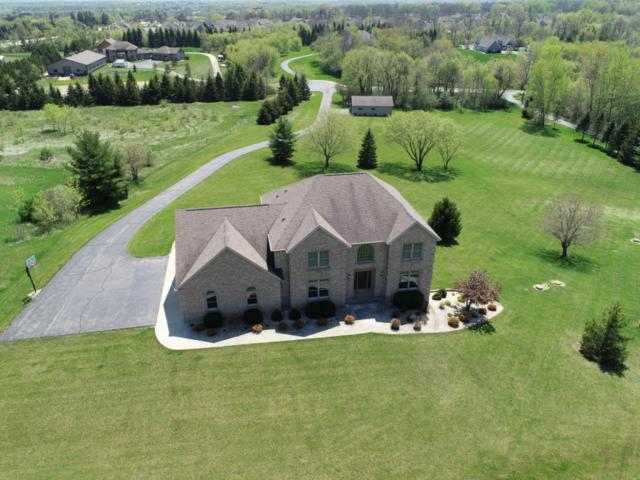 7830 Sherman Ct, Cedarburg, WI 53012 (#1581972) :: Tom Didier Real Estate Team