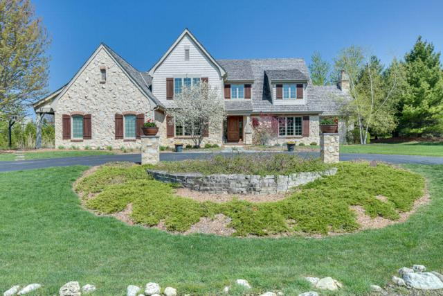10544 N Wood Crest Dr, Mequon, WI 53092 (#1582419) :: Tom Didier Real Estate Team