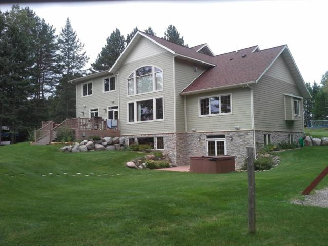 5001 Cals Ln, Florence, WI 54121 (#1587516) :: RE/MAX Service First Service First Pros