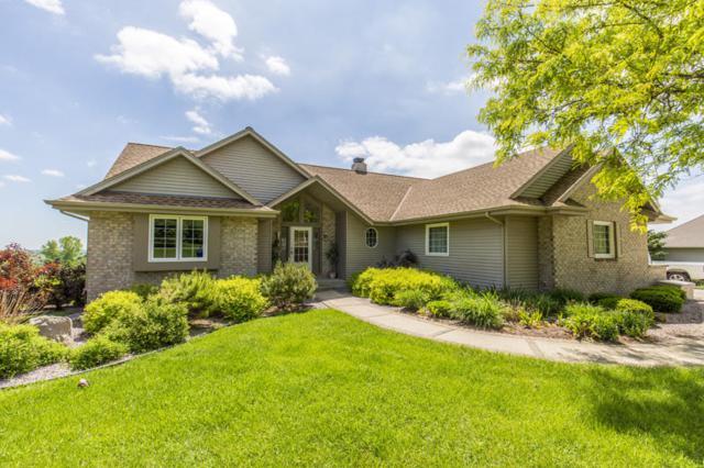 N773 Oak Ridge Dr, Ashippun, WI 53066 (#1587995) :: Tom Didier Real Estate Team