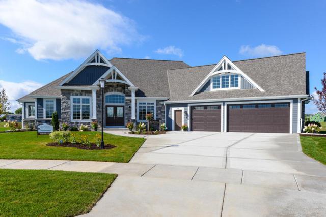 112 Sycamore Ct, Hartland, WI 53029 (#1593507) :: Tom Didier Real Estate Team