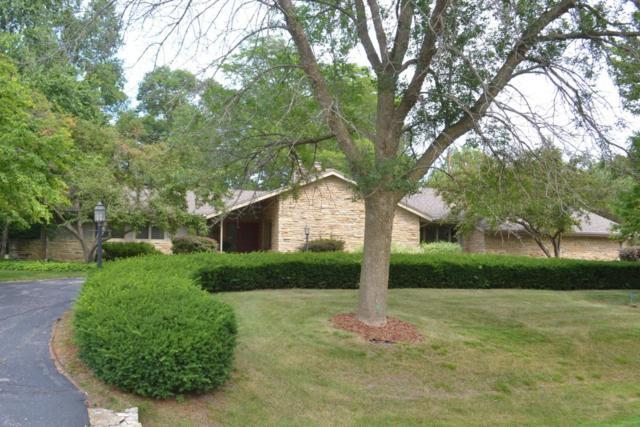8632 N Seneca Rd, Fox Point, WI 53217 (#1596269) :: Tom Didier Real Estate Team