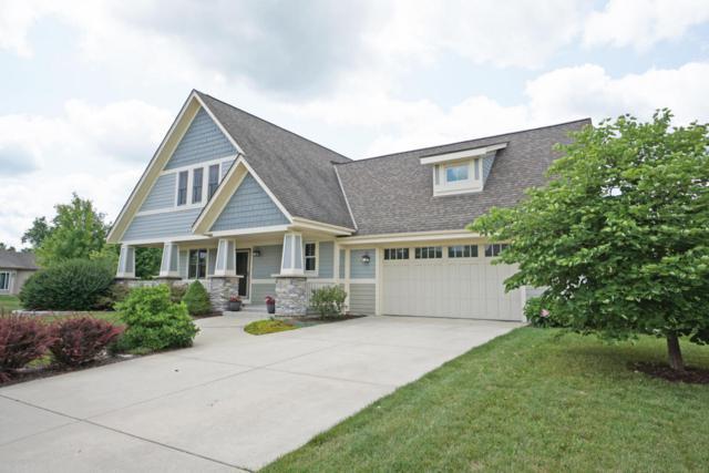 4131 Oakmont Trl, Waukesha, WI 53188 (#1597881) :: Tom Didier Real Estate Team