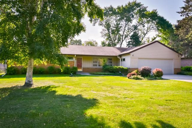 6820 N Yates Rd, Fox Point, WI 53217 (#1598922) :: Tom Didier Real Estate Team