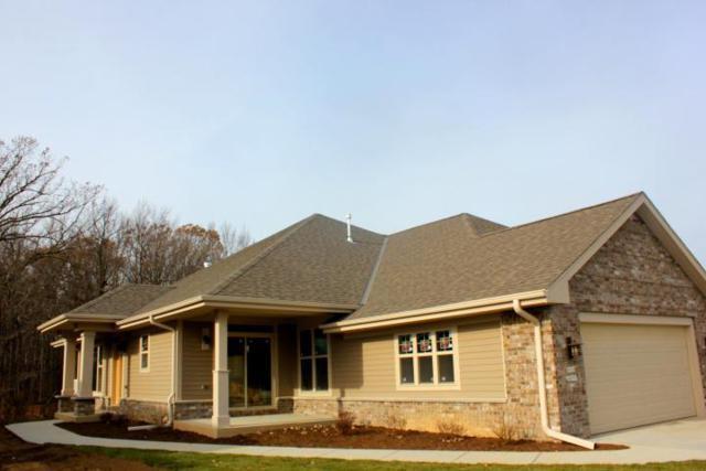 N67W12949 Northfield Cir #1302, Menomonee Falls, WI 53051 (#1599477) :: Vesta Real Estate Advisors LLC
