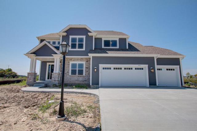 8241 W Highlander Dr, Mequon, WI 53097 (#1600591) :: Vesta Real Estate Advisors LLC