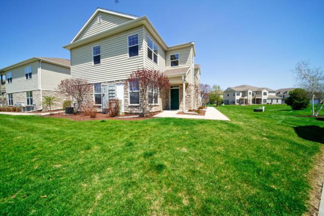 N17W26538 Meadowgrass Cir F, Pewaukee, WI 53072 (#1600851) :: Vesta Real Estate Advisors LLC