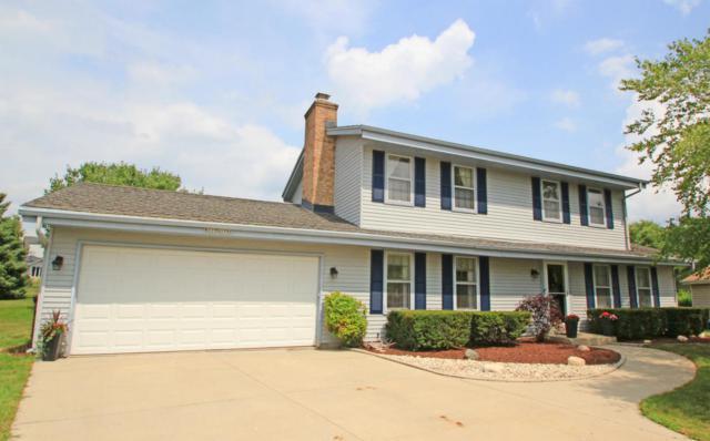 W225N2796 Fernwood Ct, Pewaukee, WI 53186 (#1601341) :: Vesta Real Estate Advisors LLC