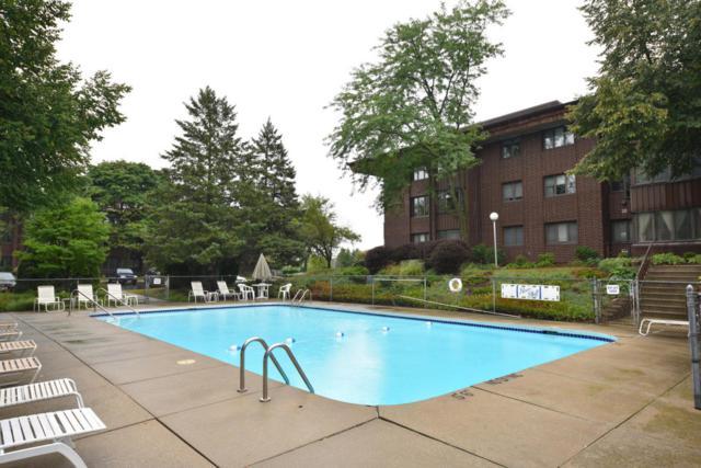 N85W15650 Ridge Rd #103, Menomonee Falls, WI 53051 (#1601642) :: Vesta Real Estate Advisors LLC