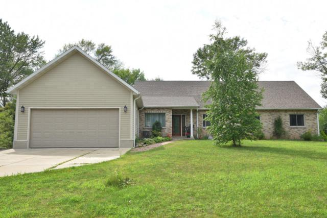 8209 N Port Washington Rd, Fox Point, WI 53217 (#1601704) :: Tom Didier Real Estate Team