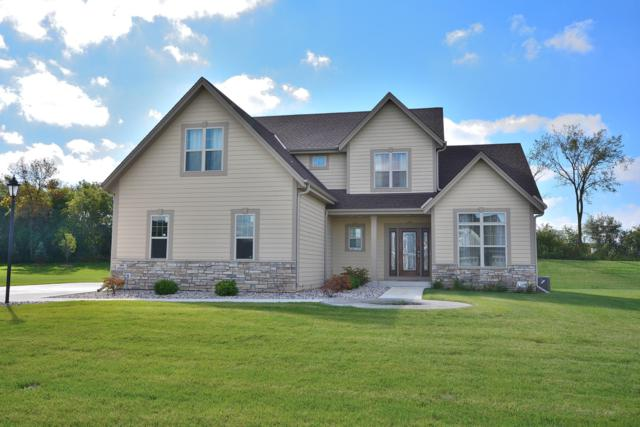 N60W13671 Weyerhaven Dr, Menomonee Falls, WI 53051 (#1607734) :: RE/MAX Service First Service First Pros