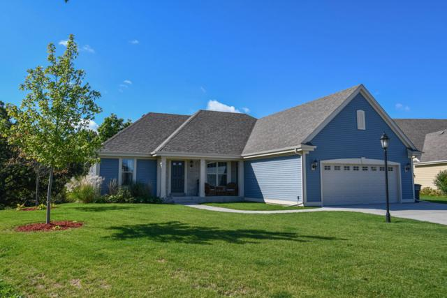 2855 Oakmont Dr, East Troy, WI 53120 (#1607790) :: Tom Didier Real Estate Team