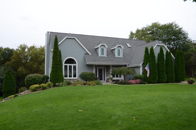 1143 Forseth Dr, Hartland, WI 53029 (#1609116) :: RE/MAX Service First