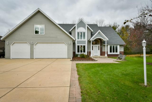 1063 Woodview Dr, Grafton, WI 53024 (#1610418) :: Tom Didier Real Estate Team