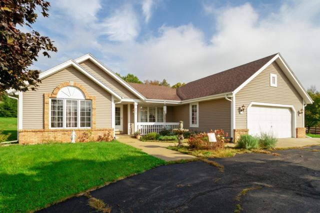 W422 Potter Rd, Spring Prairie, WI 53105 (#1610784) :: RE/MAX Service First