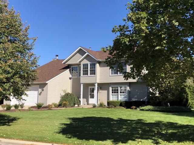 8275 66th Ave, Pleasant Prairie, WI 53158 (#1611022) :: Tom Didier Real Estate Team