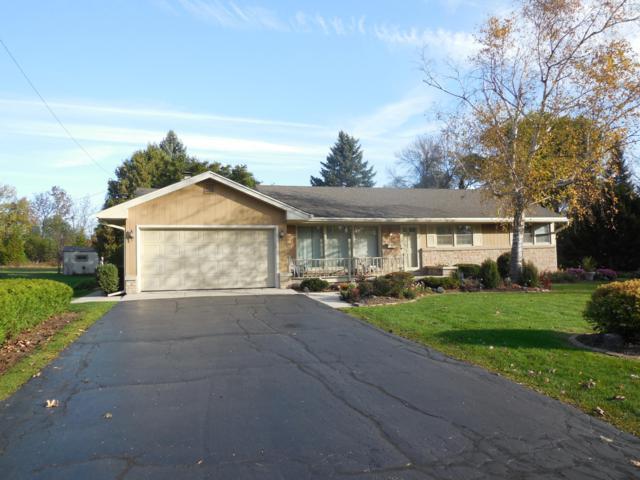 N87W15380 Kings Hwy, Menomonee Falls, WI 53051 (#1611393) :: Vesta Real Estate Advisors LLC