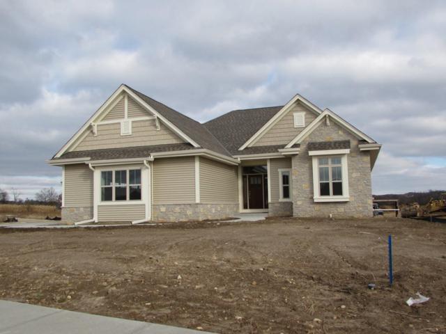 235 Farmstead Dr E, Slinger, WI 53086 (#1612341) :: Tom Didier Real Estate Team