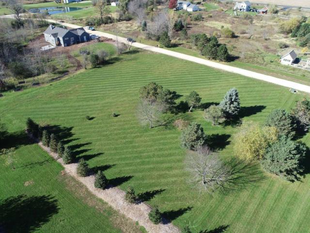 1127 County Road C, Grafton, WI 53024 (#1612755) :: Tom Didier Real Estate Team