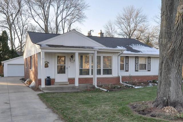 7525 N Seneca Rd, Fox Point, WI 53217 (#1614280) :: Tom Didier Real Estate Team