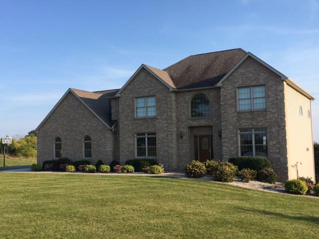 7830 Sherman Ct, Cedarburg, WI 53012 (#1615346) :: Tom Didier Real Estate Team