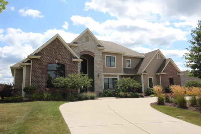 1241 Mary Hill Cir, Hartland, WI 53029 (#1615679) :: RE/MAX Service First