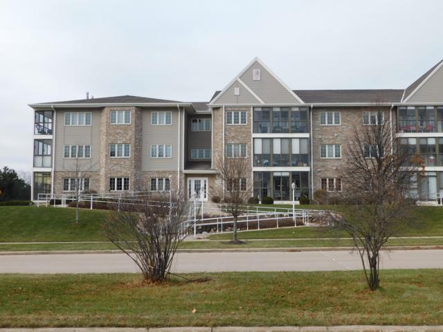 2111 1st Ave #104, Grafton, WI 53024 (#1616061) :: Tom Didier Real Estate Team