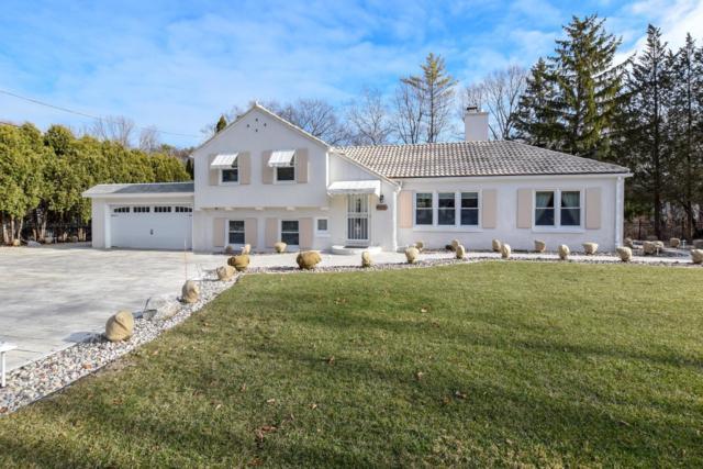 7126 N Lake Dr, Fox Point, WI 53217 (#1616531) :: Tom Didier Real Estate Team