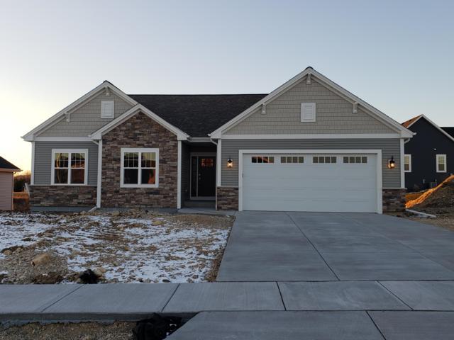 525 Spur N Rd, Slinger, WI 53086 (#1616770) :: Tom Didier Real Estate Team