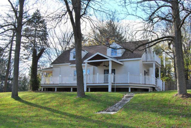 730 W Green Tree Rd, River Hills, WI 53217 (#1622299) :: Tom Didier Real Estate Team