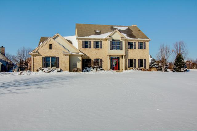 406 Prairie Grass Ct, Hartland, WI 53029 (#1624408) :: RE/MAX Service First Service First Pros